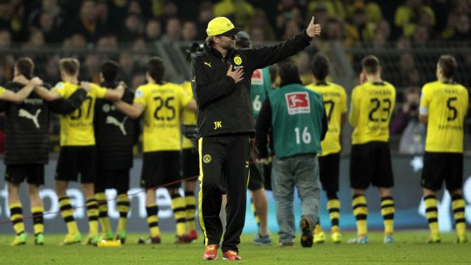 Borussia Dortmund's coach Klopp gives a thumb after the German first division Bundesliga soccer match against Schalke 04 in Dortmund
