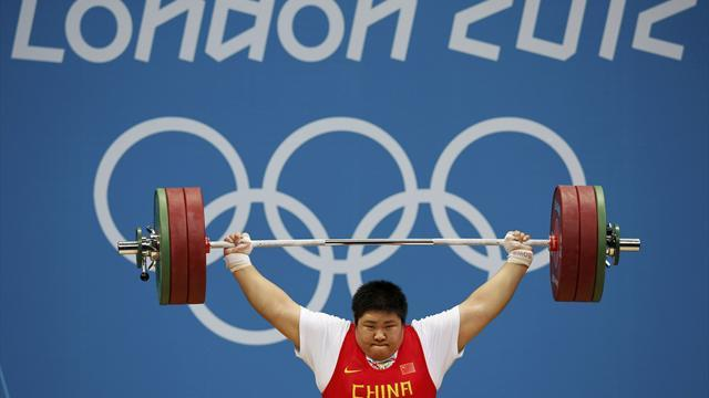 Olympic Games - Zhou sets record to win Olympic super heavyweight gold