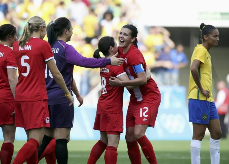 Christine Sinclair and Diana Matheson of Canada celebrate after defeating Brazil in Rio. REUTERS/Paulo Whitaker