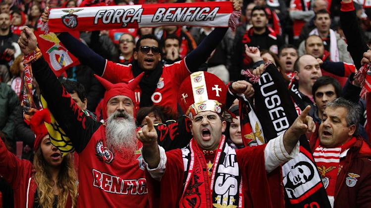 Benfica supporters cheer prior to the Portuguese league soccer match between Benfica and Porto at Benfica's Luz stadium in Lisbon, Sunday, Jan. 12, 2014. Benfica won 2-0
