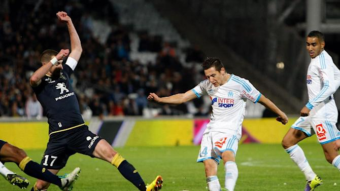 Marseille's French midfielder Florian Thauvin, right, challenges for the ball with Sochaux's French defender Mathieu Peybernes, during their League One soccer match, at the Velodrome Stadium, in Marseille, southern France, Sunday, Nov. 10, 2013