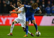 Swansea defender Chico Flores (left) and Chelsea's David Luiz at The Liberty stadium in Cardiff, January 23, 2013. Flores is set to miss the League Cup final against Bradford City later this month after rupturing ligaments in his right ankle in Saturday's win over QPR
