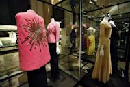 "A ""Phoebus"" cape by Italian designer Elsa Schiaparelli (1938-1939) is seen on display at the storage of the Galliera fashion museum in Paris, on February 25, 2013. A landmark exhibition due to open in Paris on Saturday traces the history of haute couture through some of the most exquisite dresses ever made"
