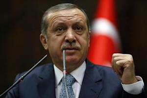 Turkey's Prime Minister Tayyip Erdogan addresses members of parliament from his ruling AK Party during a meeting at the Turkish parliament in Ankara