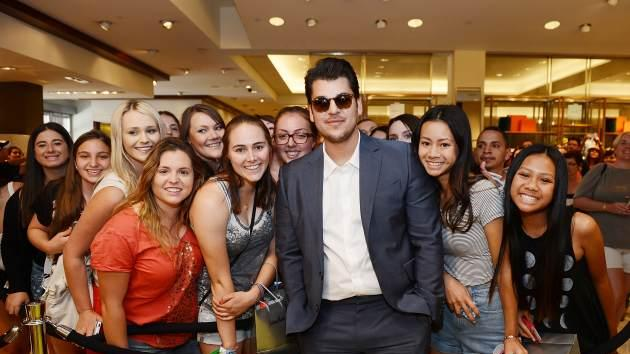 Rob Kardashian poses for photos with fans during his new Arthur George by Rob Kardashian sock collection unveiling at Neiman Marcus on May 25, 2013 in Las Vegas -- Getty Premium