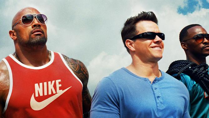 "This undated publicity photo released by courtesy of Paramount Pictures shows, from left, Dwayne Johnson as Paul Doyle, Mark Wahlberg as Daniel Lugo and Anthony Mackie as Adrian Doorbal in the film, ""Pain and Gain,"" directed by Michael Bay from Paramount Pictures. The film releases in theaters April 26, 2013. (AP Photo/Paramount Pictures)"