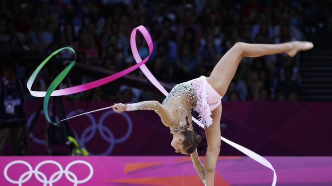 Russia's Evgeniya Kanaeva competes using the ribbon in the individual all-around rhythmic gymnastics final at the London 2012 Olympic Games