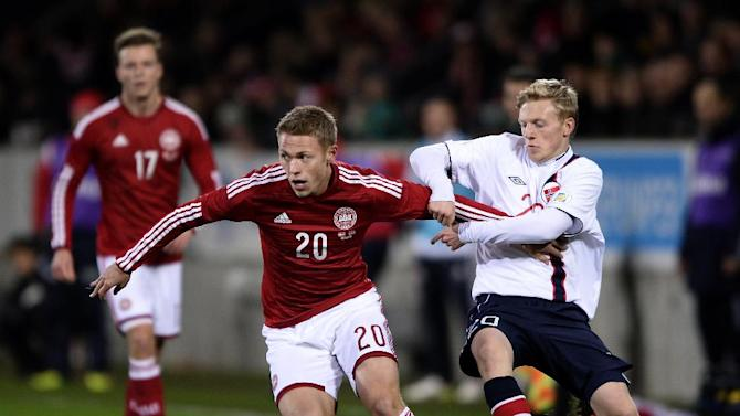 Norway's Mats Moller Dahli, left and Denmark's Viktor Fischer, right, compete for the ball during their international friendly match in Herning, Denmark, Friday, Nov. 15. 2013