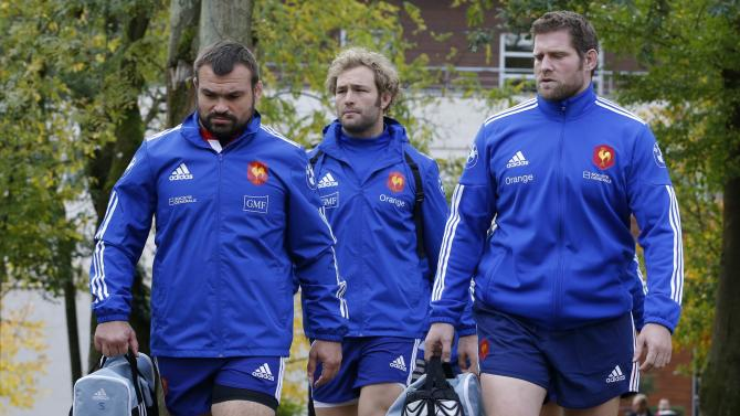 From left to right France national rugby team players Mas, Claassen and Debaty arrive to attend a training session at the Rugby Union National Centre in Marcoussis