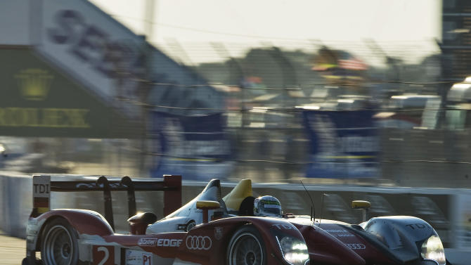 Audi Sport Team Joest's Allan McNish, of Scotland, steers the Audi R15+ TDI through Turn 1 before sunset during the 59th annual American Le Mans Series 12 Hours of Sebring auto race at the Sebring International Raceway Saturday, March 19, 2011 in Sebring, Fla. (AP Photo/Steve Nesius)