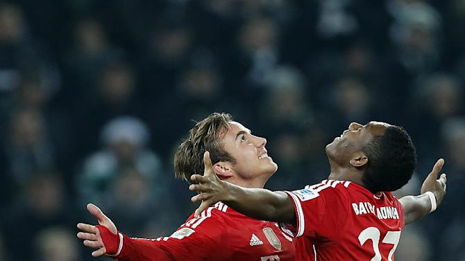 Bayern's Mario Goetze, left, and Bayern's David Alaba of Austria celebrate after scoring during the German first division Bundesliga soccer match between VfL Borussia Moenchengladbach and Bayern Munich in Moenchengladbach, Germany, Friday, Jan. 24, 2014