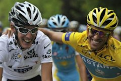 Photo 1 - (FILES) Photo Taken On July 25, 2010 Of Yellow Jersey Of Overall Leader, Spain's Alberto Contador (R) Riding With White AFP/Getty Images