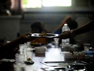 Children eat during school time in the Parish of San Antonio Abab, in Sevilla, on August 29, 2013. Welfare groups warn that many children are suffering in Spain after five years of on-off recession