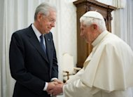 This picture released by the Vatican press office on February 16, 2013 shows Pope Benedict XVI (L) greeting Italy's outgoing Prime Minister Mario Monti during a private audience in the pontiff's library at the Vatican