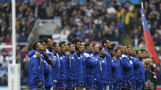 Samoa line up for their national anthem before the game