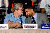LAS VEGAS, NV - JULY 12: Boxer Amir Khan's trainer Freddie Roach (L) and Khan speak with each other during the final news conference at the Mandalay Bay Resort & Casino on July 12, 2012 in Las Vegas, Nevada. Khan will take on Danny Garcia for the WBC super lightweight world championship on July 14 in Las Vegas. (Photo by David Becker/Getty Images)