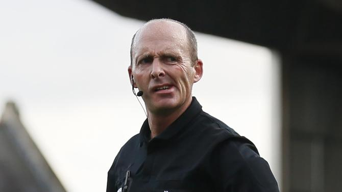 Referee Dean reacts during the English Premier League soccer match between Fulham and Aston Villa at Craven Cottage in London