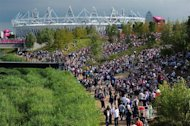 Visitors walk towards The Olympic Stadium in the London 2012 Olympic Park in east London on August 8, 2012, during The 2012 London Olympic Games. AFP PHOTO / CARL COURT