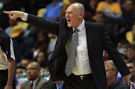 Head coach George Karl leads the Denver Nuggets against the Golden State Warriors during Game Five of the Western Conference Quarterfinals of the 2013 NBA Playoffs at the Pepsi Center on April 30, 2013 in Denver, Colorado. Karl was named the NBA Coach of the Year on Wednesday, the first time in his 25-year career he claimed the award