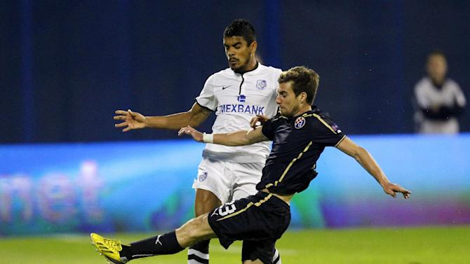 Chornomorets Odessa's Leonardo, left, is challenged by Dinamo Zagreb's Ruben Lima during their Europa League  group B soccer  match,   in Zagreb, Croatia, Thursday, Sept. 19, 2013