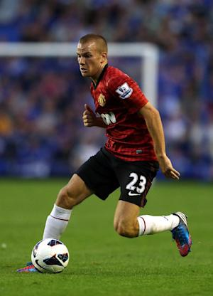 Tom Cleverley has been told to maintain the highest of standards at Manchester United