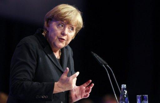 "German chancellor Angela Merkel speaks on October 5 at a Youth Union convention in Rostock. Merkel will travel to Greece on Tuesday with a message of support for the ""ambitious"" cuts already in place in Athens but also encouragement to maintain the efforts, her spokesman said."