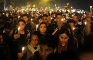Indian protesters hold candles during a rally in New Delhi late December 29, 2012. The body of a gang-rape victim arrived back in New Delhi on Sunday after her death from sickening injuries in a Singapore hospital as India was engulfed by a mass outpouring of grief and anger