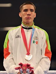 Silver medal winner Oscar Valdez of Mexico stands at the podium after receiving their awards in the men's bantam-weight boxing category in the XVI Pan-American Games in Guadalajara, Mexico, on October 28, 2011. AFP PHOTO/CRIS BOURONCLE