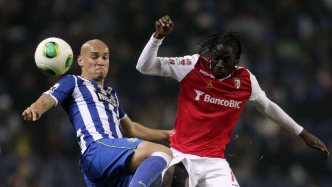 Porto's Maicon fights for the ball with Braga's Ederzito during their Portuguese Premier League soccer match at the Dragao stadium in Porto