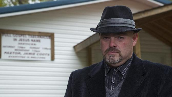 "In this 2013 photo provided by National Geographic Channel, Jamie Coots, a pastor in Middlesboro, Ky., who appeared on the National Geographic television reality show ""Snake Salvation,"" poses for a photo. Coots died Sunday, Feb. 16, 2014, after being bitten by a snake. (AP Photo/Courtesy National Geographic Channel)"