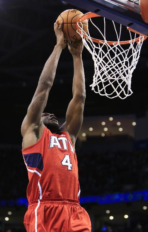 Atlanta Hawks forward Paul Millsap (4) dunks during the second quarter of an NBA basketball game against the Oklahoma City Thunder, Monday, Jan. 27, 2014, in Oklahoma City