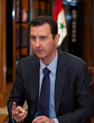 A picture released by the official Syrian Arab News Agency (SANA) on October 21, 2013, shows President Bashar al-Assad giving an interview to Lebanese channel al-Mayadeen in Damascus
