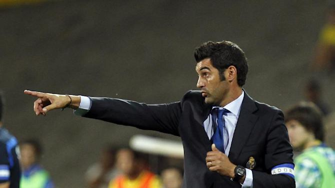 Porto's coach Paulo Fonseca gives instructions during the Portuguese league soccer match between Estoril and Porto at the Antonio Coimbra da Mota stadium in Estoril, near Lisbon, Sunday, Sept. 22, 2013. The match ended in a 2-2 draw