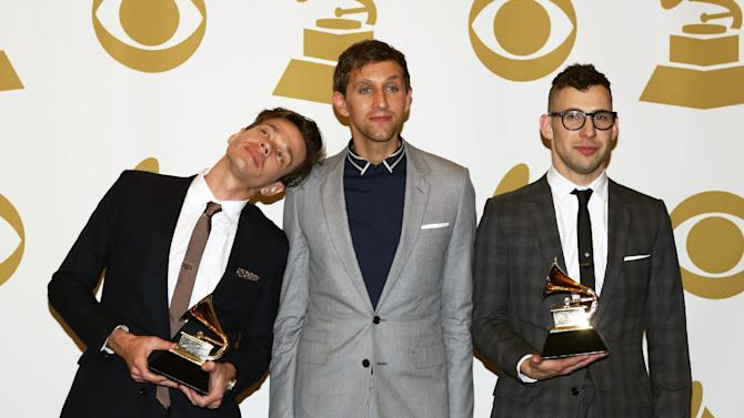 "Members of fun., from left, Nate Ruess, Andrew Dost and Jack Antonoff, pose backstage with the song of the year award for ""We Are Young"" at the 55th annual Grammy Awards on Sunday, Feb. 10, 2013, in Los Angeles. (Photo by Matt Sayles/Invision/AP)"