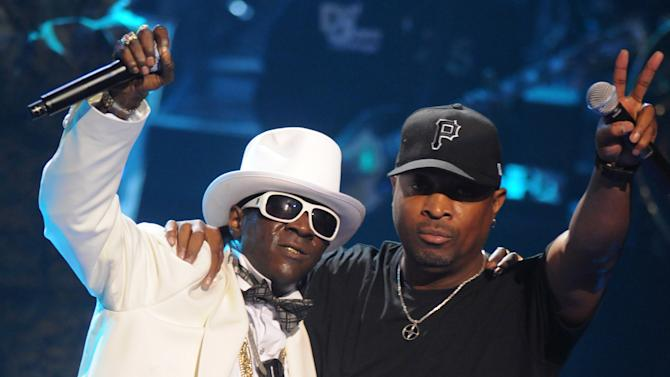 "FILE - This Sept. 23, 2009 file photo shows Rappers Flavor Flav, left, and Chuck D of the music group Public Enemy, perform at the 2009 VH1 Hip Hop Honors at the Brooklyn Academy of Music, in New York. The eclectic group of rockers Rush and Heart, rappers Public Enemy, songwriter Randy Newman, ""Queen of Disco"" Donna Summer and bluesman Albert King will be inducted into the Rock and Roll Hall of Fame next April in Los Angeles. The inductees were announced Tuesday by 2012 inductee Flea of The Red Hot Chili Peppers at a news conference in Los Angeles. (AP Photo/Peter Kramer, file)"