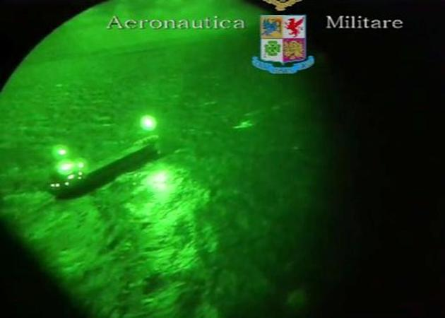 An image grab taken from a video made available by the Aeronautica Militare Italiana on December 30, 2014 shows the Moldovan-flagged ship Blue Sky M in the Mediterranean Sea