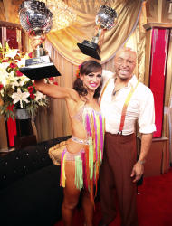 "In this image released by ABC-TV, war veteran and actor J.R. Martinez, right, and his partner Karina Smirnoff hold their award after they were crowned champions of the celebrity dance competition series, ""Dancing with the Stars,"" Tuesday, Nov. 22, 2011 in Los Angeles. (AP Photo/ABC-TV, Adam Taylor)"