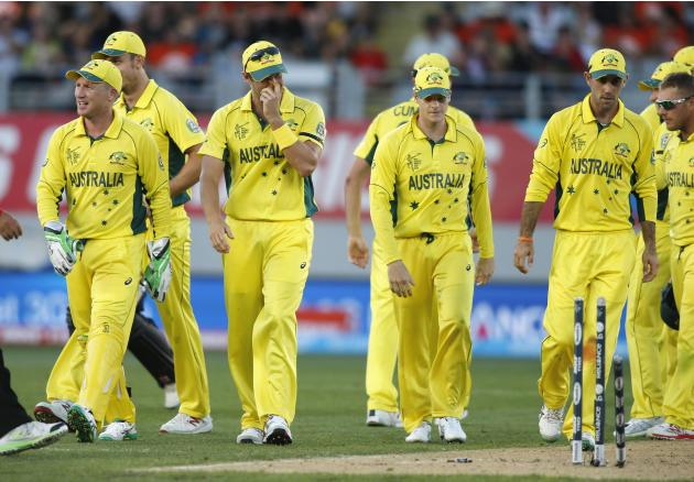 Members of the Australia team prepare to leave the field during their Cricket World Cup match against New Zealand in Auckland
