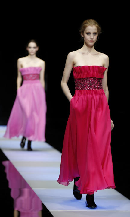 Models wear creations for Giorgio Armani women's Fall-Winter 2015-16 collection, part of Milan Fashion Week, unveiled in Milan, Italy, Monday, March 2, 2015. (AP Photo/Luca Bruno)