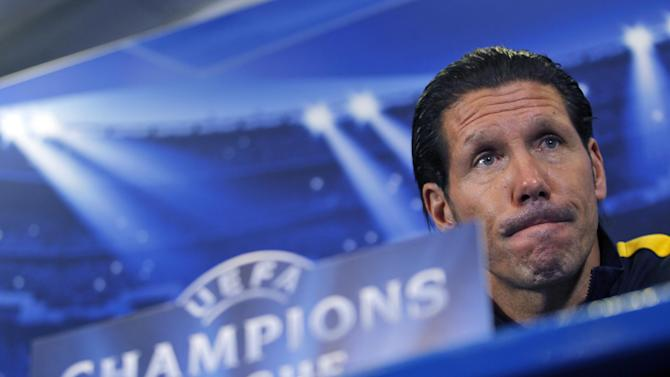 Atletico Madrid's coach Pablo Simone, from Argentina, listens to a question during a news conference at the Vicente Calderon stadium in Madrid, Tuesday, Nov. 5, 2013. Atletico Madrid will play against Austria Wien in a Champions League Group G soccer match on Wednesday