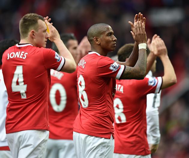 Manchester United's players applaud the crowd after their English Premier League match against Arsenal, at Old Trafford in Manchester, north-west England, on May 17, 2015