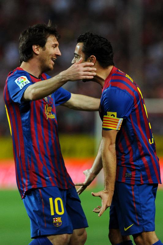 Barcelona's Midfielder Xavi Hernandez (R) Celebrates AFP/Getty Images