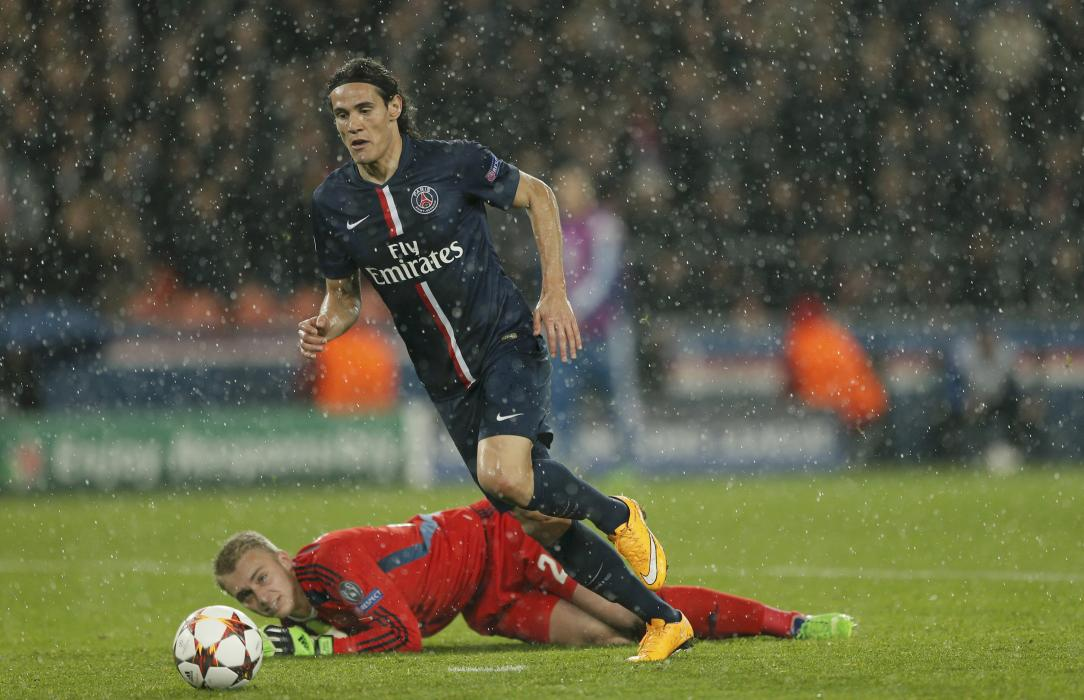 Paris St Germain's Edinson Cavani in action as he scores on goal against Ajax Amsterdam's Jasper Cillessen during their Champions League Group...