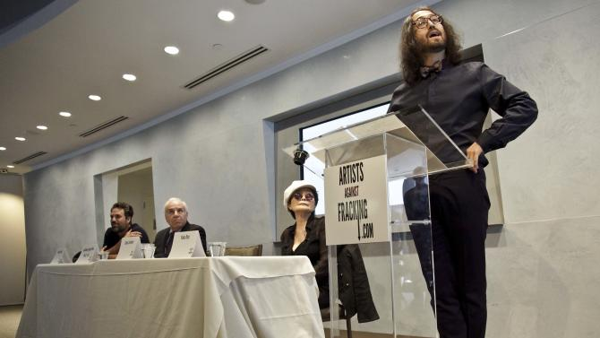 "Actor and activist Mark Ruffalo, far left, Cornell University Professor Anthony Ingrafffea, second from left, and Yoko Ono, second from right, listens as Sean Lennon speaks during a press conference to launch a coalition of artists opposing hydraulic fracturing on Wednesday, Aug. 29, 2012 in New York. The formation of the group, called Artists Against Fracking, comes as New York Gov. Andrew Cuomo decides whether to allow shale gas drilling using high-volume hydraulic fracturing called hydrofracking. The group says such drilling is harmful and poses the threat of contamination. They say they want to spread awareness of the issue through ""peaceful democratic action.""  Cuomo is expected to allow drilling to begin on a limited basis near the Pennsylvania border. The group is comprised of 146 members including Lady Gaga, Paul McCartney and Alec Baldwin. (AP Photo/Bebeto Matthews)"