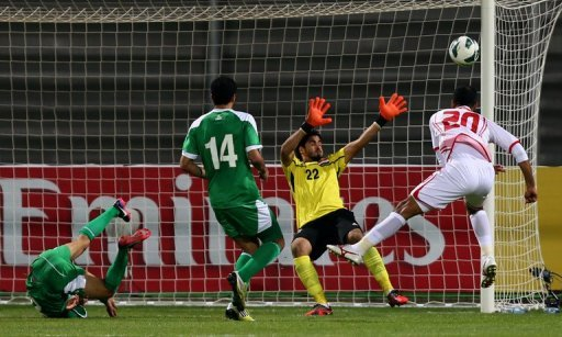 Ali Salem (R) of UAE heads the ball in front of Iraq's goalkeeper during the 21st Gulf Cup final between UAE and Iraq on January 18, 2013 in Manama. Iraq's state broadcaster has announced the suspension of a television commentator after he insulted a Saudi referee live on air during last week's Gulf Cup final between Iraq and the UAE