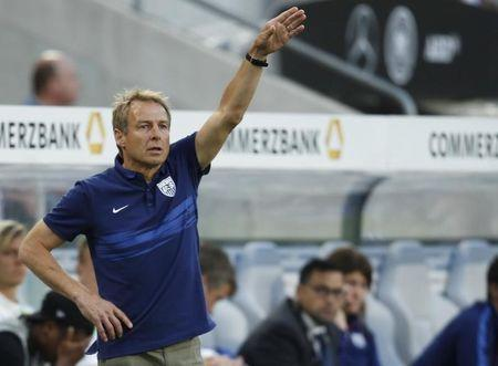 U.S. national soccer team coach Klinsmann gestures during their international friendly soccer match against Germany in Cologne