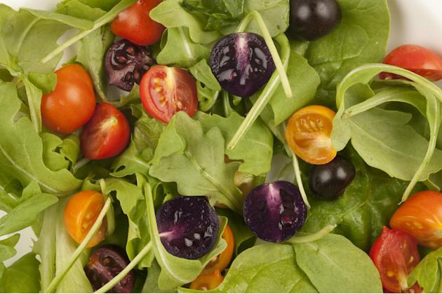 This image provided by The John Innes Centre, UK, shows a salad made with red and purple tomatoes. A small British company is planning to apply for U.S. permission to produce and sell purple tomatoes
