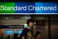 A branch of Standard Chartered bank is pictured in Hong Kong. Shares in Standard Chartered Bank have slumped after US regulators charged that it hid $250 billion in deals with Iranian banks in violation of US sanctions