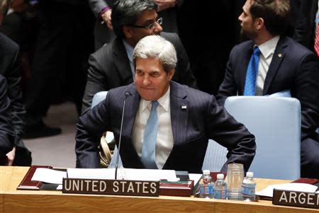 U.S. Secretary of State John Kerry takes his seat moments before the United Nations Security council voted unanimously in favor of a resolution eradicating Syria's chemical arsenal during a Security Council meeting at the 68th United Nations General Assembly in New York on September 27, 2013. REUTERS/Adrees Latif