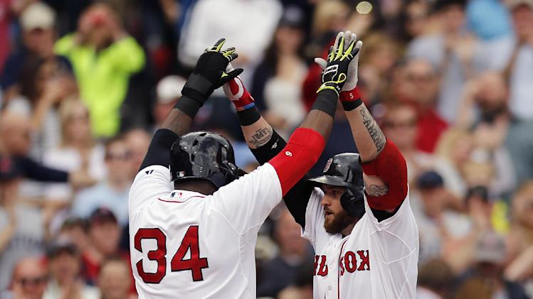 Boston red sox s jonny gomes right celebrates his grand slam with